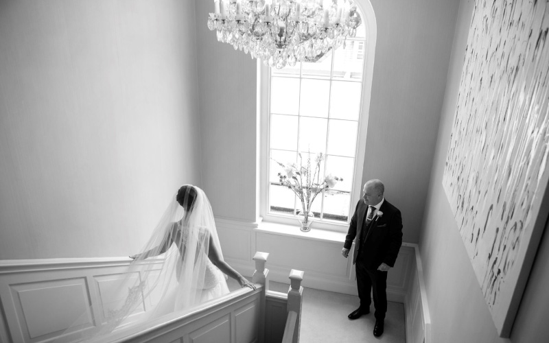 Father greets daughter before aisle walk