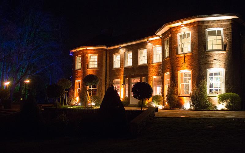Delamere Manor at night lit up