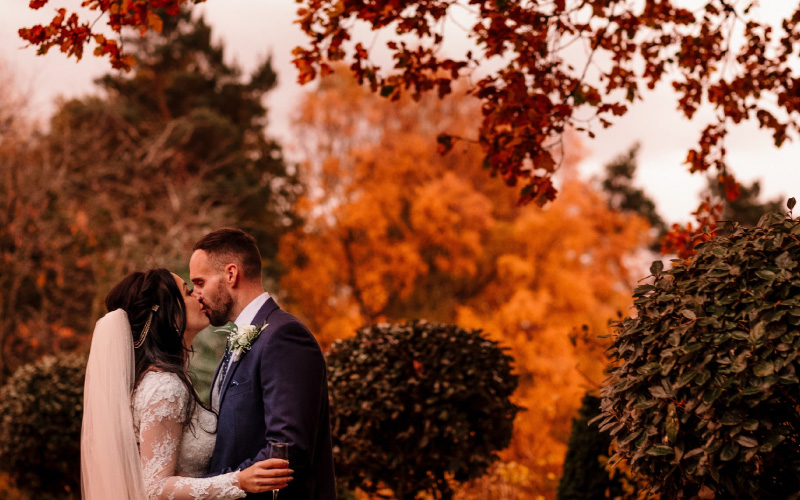 Couple kissing outdoors in the autumn
