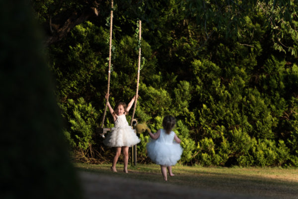 Young Children playing on swing