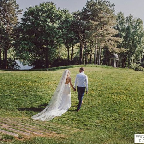Wedding Couple walking in Delamare Garden