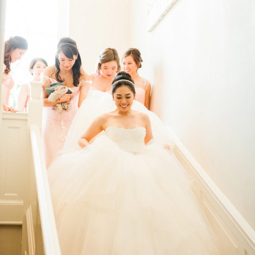 Bride with Bridemaids on the stairs