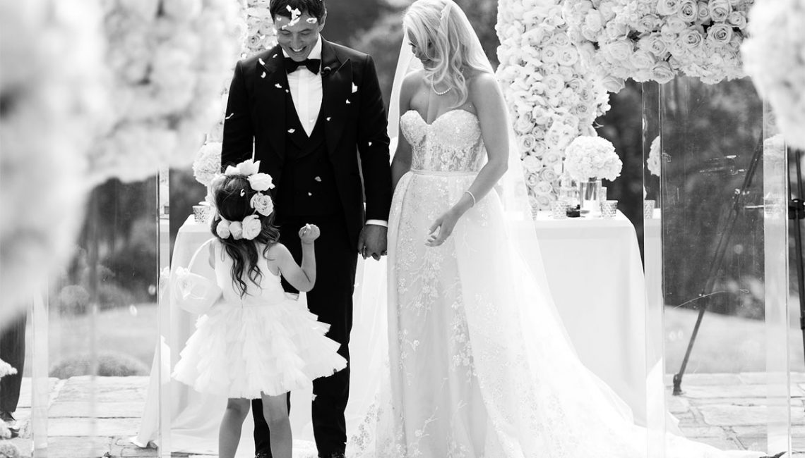 Couple greet their daughter at the alter
