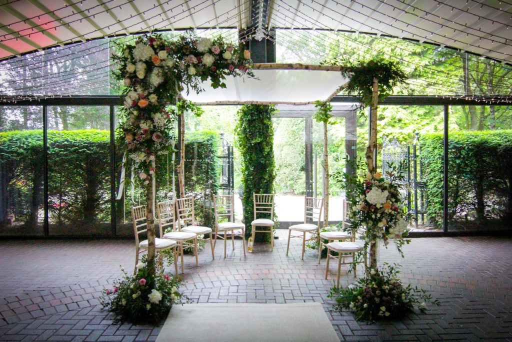 Wedding ceremony entrance with flowers