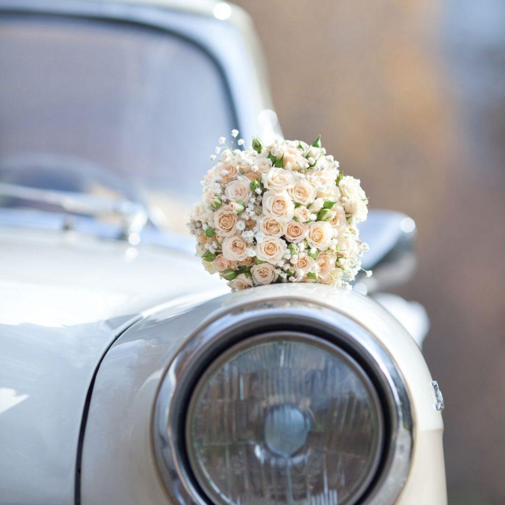 wedding flower on classic car