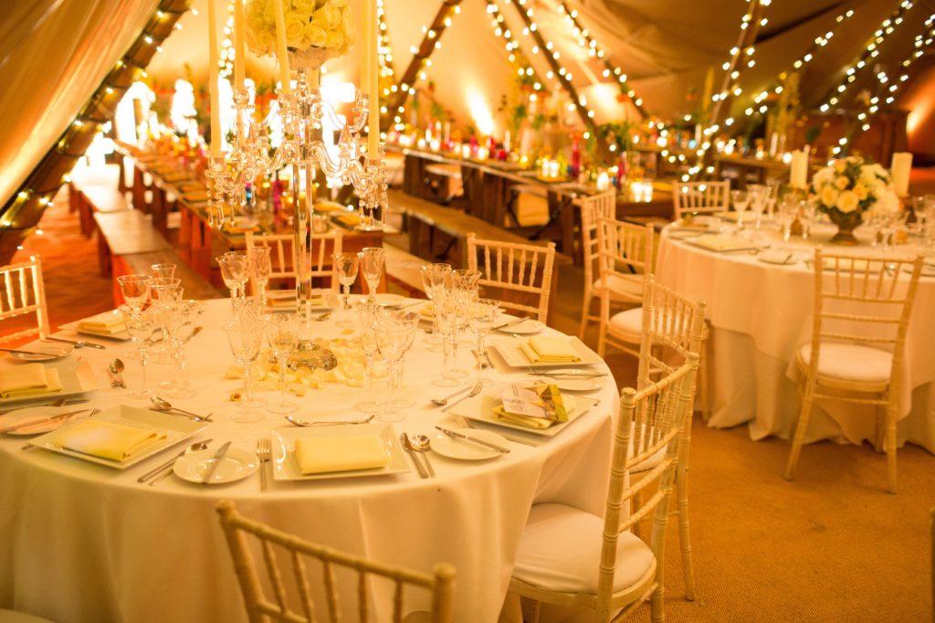 Fairy lights above wedding tables