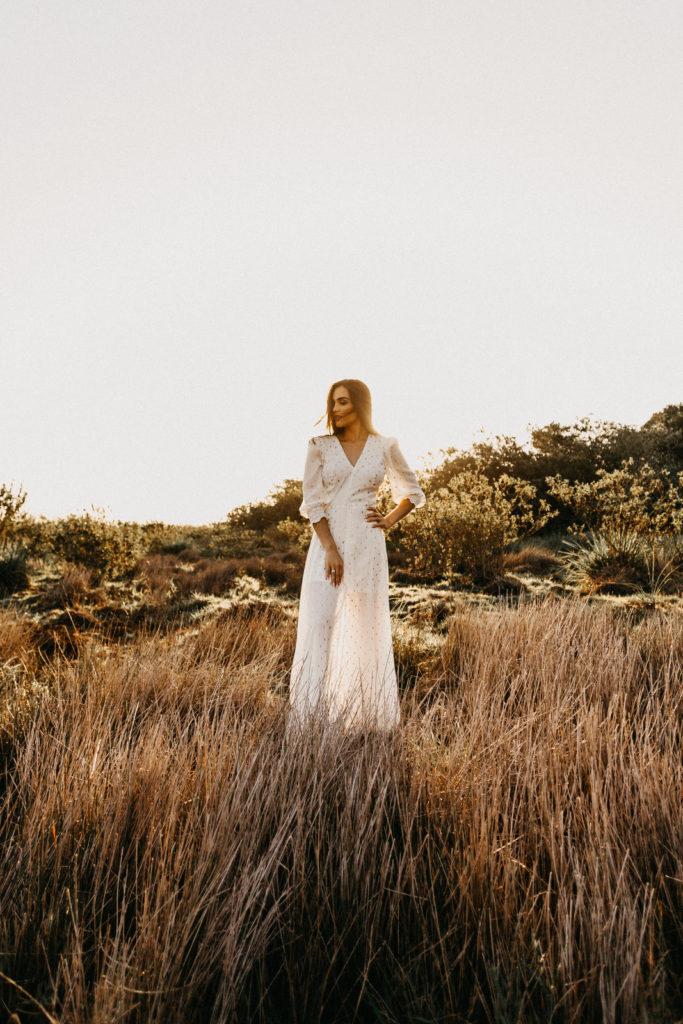Bride wearing white bridal jumpsuit