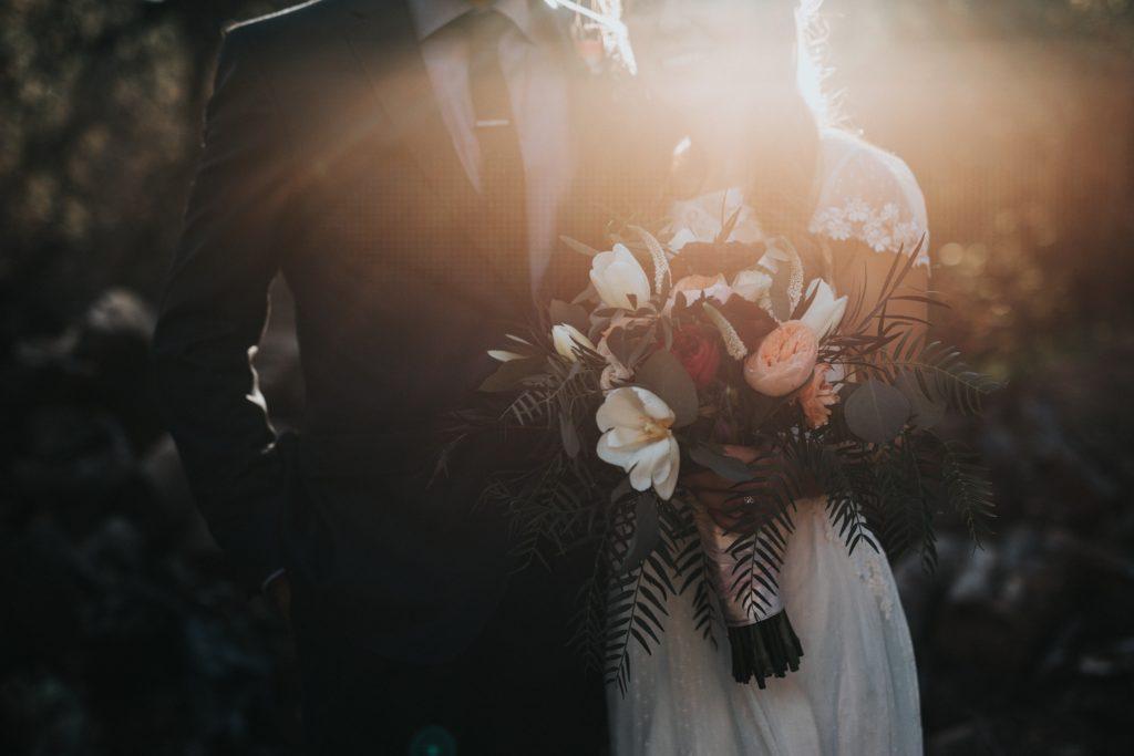 Image describes a wedding couple