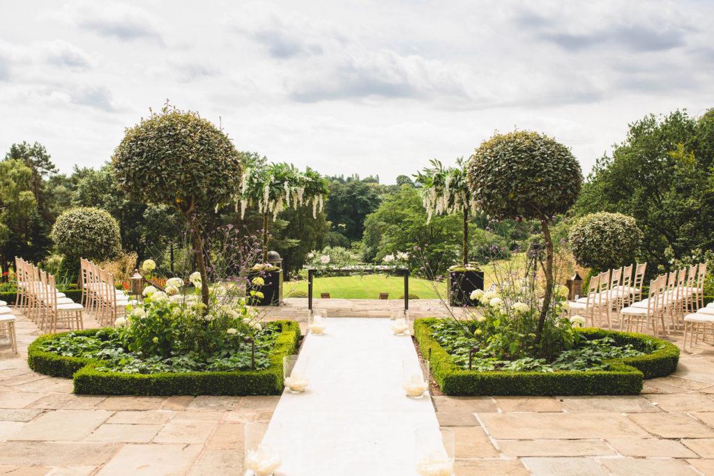 Image describes outdoor wedding setting.