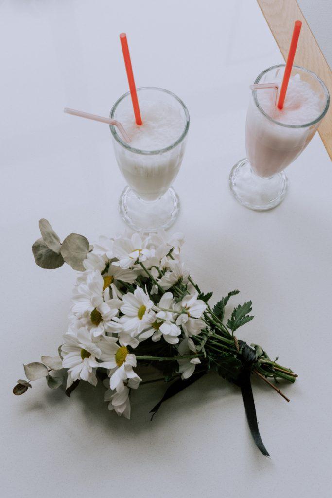 Image describes milkshakes and flowers.
