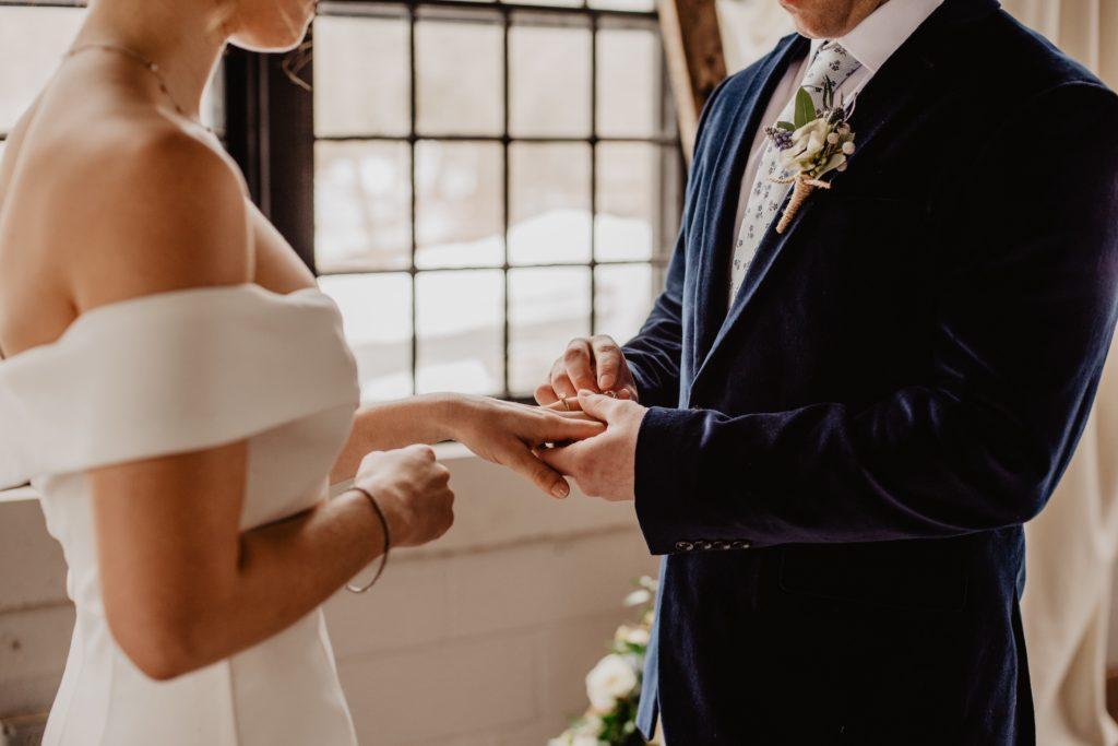 Image describes a couple sharing their vows.