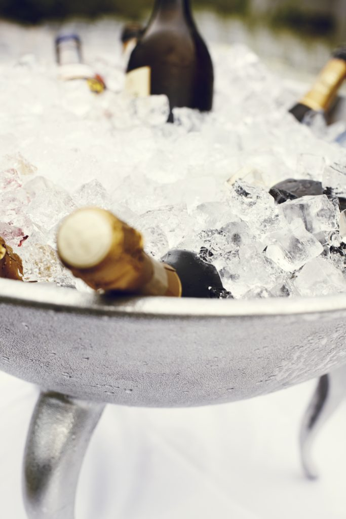 Image describes champagne on ice.