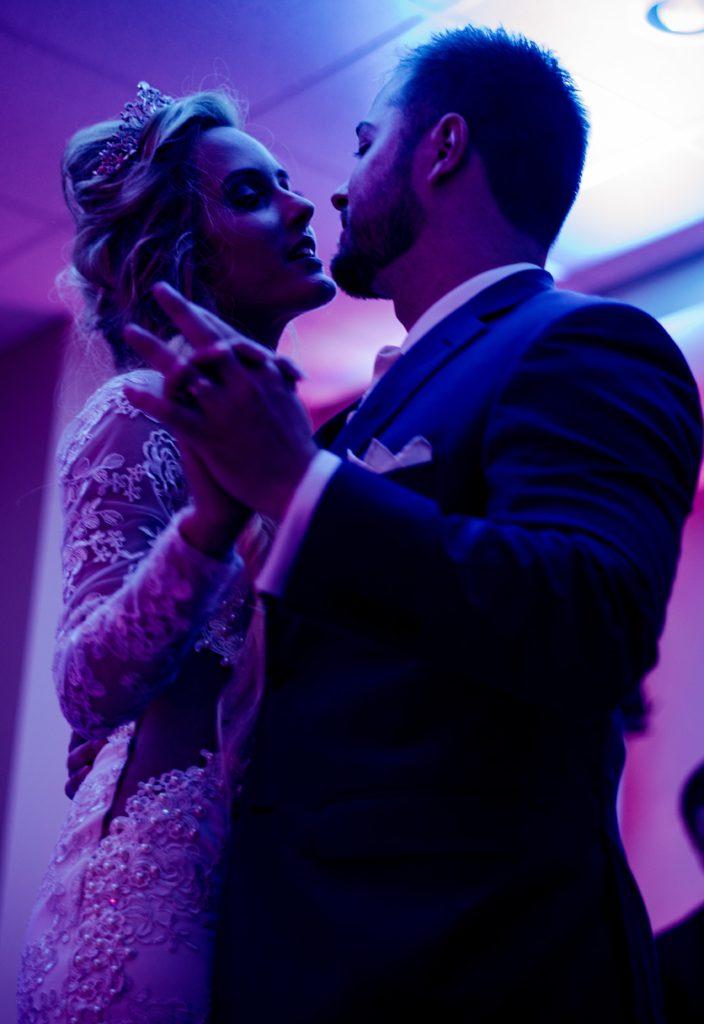 Image describes wedding couple dancing.